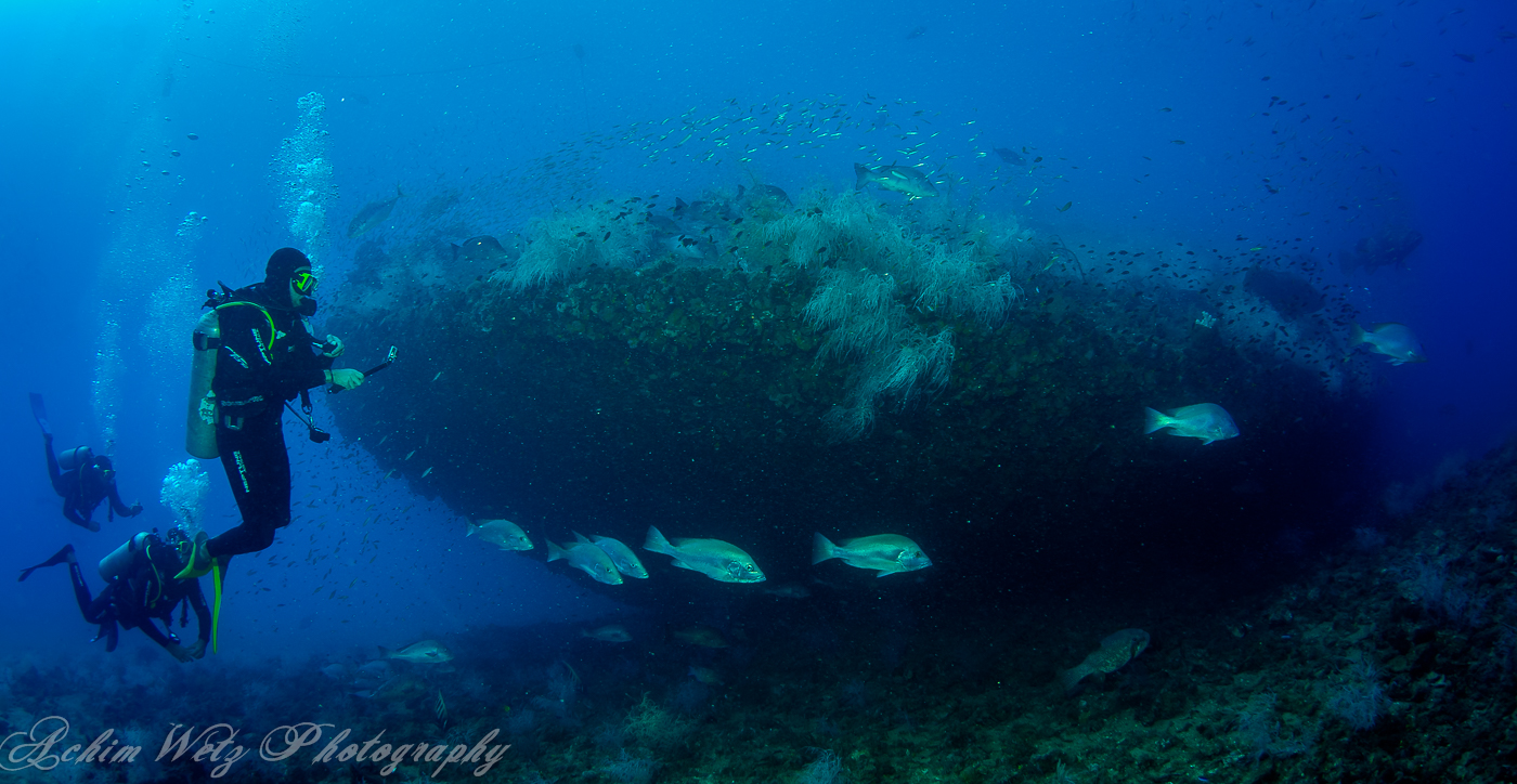 Divers on the Bow of the SS Yongala Townsville ,QLD Australia